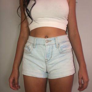 Light wash jean shorts. Size 0.
